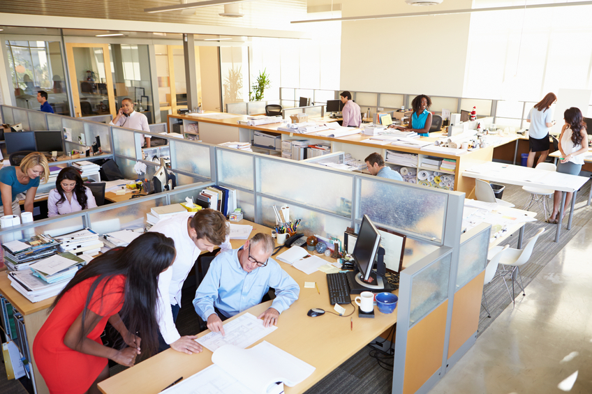 Interior Of Busy Modern Open Plan Office With Workers In