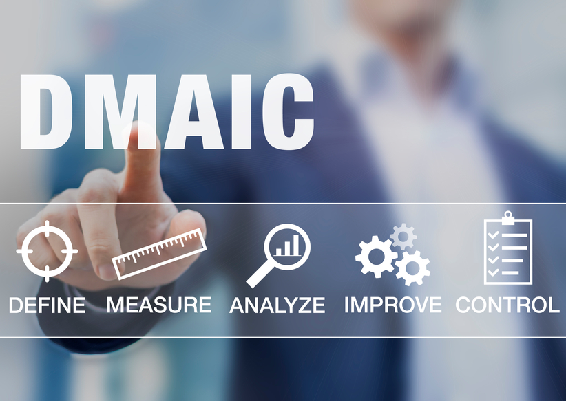 Manager presenting DMAIC continuous improvement tools for process quality
